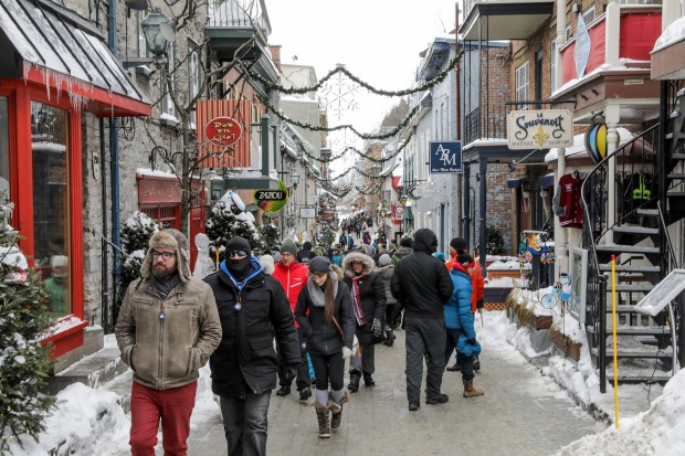 Find art galleries, gift shops, restaurants and holiday decorations into February along the brick streets of the Petit Champlain. (Brian Sirimaturos/St. Louis Post-Dispatch/TNS)