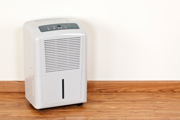 Dehumidifiers extract moisture from the air to reduce the level of humidity in the area. Shot in studio with a DSLR camera.