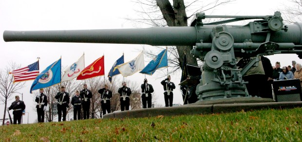 A VFW color guard stands near a gun from the USS Ward on Dec. 7, 2004, during the observance of Pearl Harbor Day on the state Capitol Mall in St. Paul. Several crew members from the Ward were on hand to mark the 63rd anniversary of the Dec. 7, 1941, Japanese attack on Hawaii that brought the United States into World War II. The Ward -- a destroyer heavily manned by naval reservists from St. Paul -- fired the first American shots of the war, sinking a Japanese miniature submarine trying to sneak into Pearl Harbor a little more than an hour before the surprise air attack. After the war ended, the men from the reserve unit formed the First Shot Naval Vets club in St. Paul. They helped get the gun from the Ward brought to St. Paul in 1958. (Craig Borck / Pioneer Press)