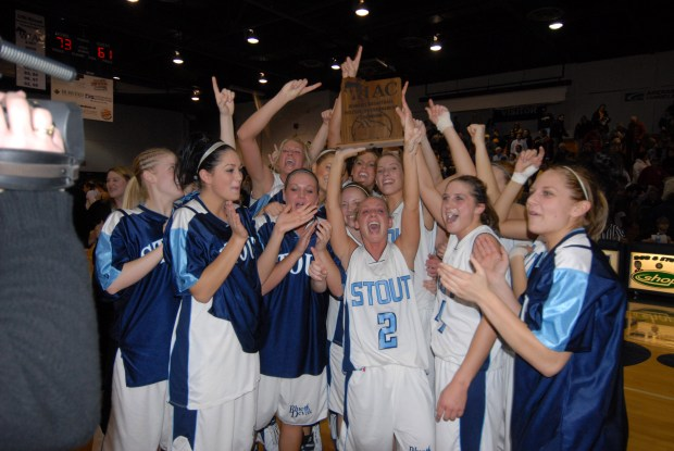Amanda Geissler, No. 2., celebrates with fellow University of Wisconsin-Stout basketball players after the team won the 2007 WIAC Championship tournament. Geissler, who previously lived in St. Paul, died in a plane crash in Costa Rica along with 9 other Americans and two crew members. (Courtesy of University of Wisconsin Stout)