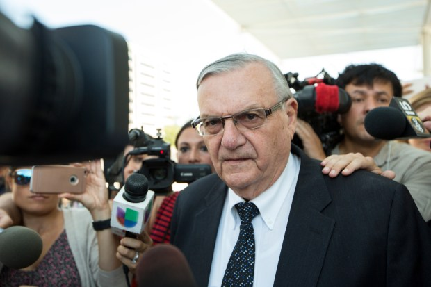 In this July 6, 2017, photo, former Sheriff Joe Arpaio leaves the federal courthouse in Phoenix, Ariz. (AP Photo/Angie Wang, File)