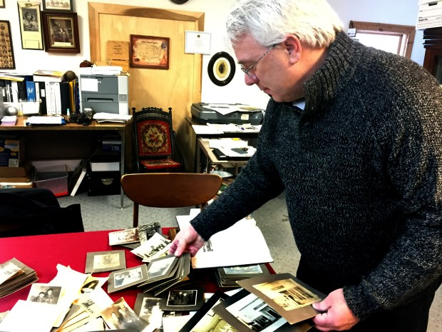 Brent Peterson, executive director of the Washington County Historical Society, sifts through a collection of historic Forest Lake photos at the society's office behind the Warden's House Museum in downtown Stillwater on Jan. 19, 2018. The photos were recently shipped to the Washington County Historical Society from the Barnes County Historical Society in Valley City, N.D. The photos, which came from a donor in Eckelson, N.D., appear to have been taken by a man named Otto Johnson. (Mary Divine / Pioneer Press)