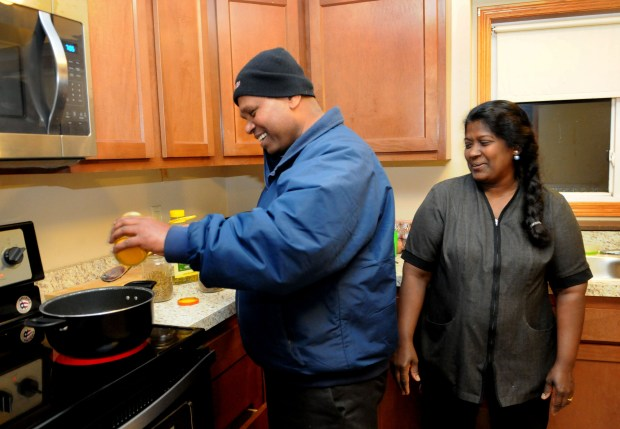 Ravindran Sivasundaram, left, and his wife, Manchuladevy Ravindram, prepare dinner in the home they recently bought in Burnsville on Friday, Oct. 27, 2017. (Ginger Pinson / Pioneer Press)
