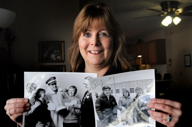 """Diane Houle holds the front-page story the Pioneer Press ran after she, her mother and her mother's good friend found the Treasure Hunt medallion in 1978, when Houle was 12. """"We were pretty seasoned hunters,"""" she said, """"so it made finding it that much more incredible."""" Houle, of Woodbury, is pictured on Tuesday, Jan. 23, 2017, in Maplewood. (Lisa Legge / Pioneer Press)"""