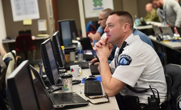 A Minneapolis police officer mans a station at the Multi Agency Command Center (MACC) in Minneapolis on Tuesday, Jan. 30, 2018. The MACC contains support from city, county, state and federal law enforcement as well as Xcel Energy and Minneapolis Public Works all in an effort to ensure safety and security at Super Bowl LII at U.S. Bank Stadium in Minneapolis. (Pioneer Press / John Autey)