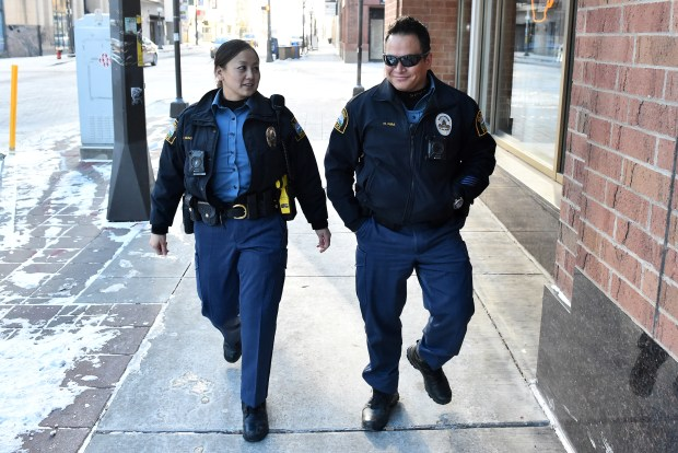 St. Paul Police Officer Mailia Yaung, left, talks with her partner, Officer Norm Pira, after responding to a call in downtown St. Paul on Monday, Jan. 1, 2018. (John Autey / Pioneer Press)