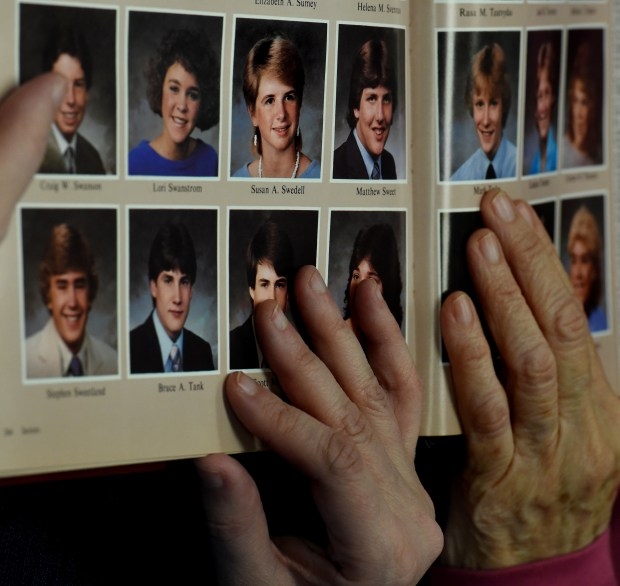 Christine and Kathy Swedell show Susan Swedell's yearbook picture from a Stillwater High School class of 1986 yearbook Wednesday, Dec. 20, 2017 in Minneapolis. Christine's sister and Kathy's daughter, Susan Swedell, disappeared in 1988 after leaving work and stopping at a gas station near her home in Lake Elmo. (Jean Pieri / Pioneer Press)