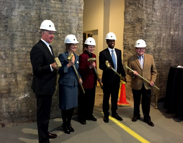 From left, former St. Paul mayor Chris Coleman, Minnesota Museum of American Art executive director Kristin Makholm, State Rep. Alice Hausman, St. Paul mayor Melvin Carter and Jim Rustad, chairman of the museum board, hold golden sledgehammers in a symbolic groundbreaking for the expansion of the Minnesota Museum of American Art in the Pioneer Endicott building on Robert Street in St. Paul on Tuesday, Jan. 30, 2018. (Kathy Berdan / Pioneer Press)