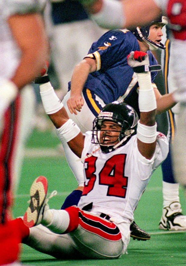 Atlanta Falcon's Ray Buchanan, bottom, celebrates as Minnesota Vikings kicker Gary Anderson, rear, misses a 39-yard field goal attempt late in the fourth quarter of the NFC Championship game at the Metrodome in Minneapolis on Sunday, January 17, 1999. The Falcons went on to win in overtime, 30-27, to put them in the Super Bowl. (Joe Rossi / Pioneer Press)