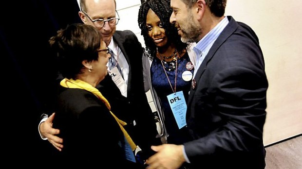Candidates for St. Paul school board, from left, Mary Vanderwert, Jon Schumacher, Zuki Ellis and Steve Marchese hug onstage after their endorsement at the St. Paul city DFL convention on Sunday, April 19, 2015. (Pioneer Press: Sherri LaRose-Chiglo)