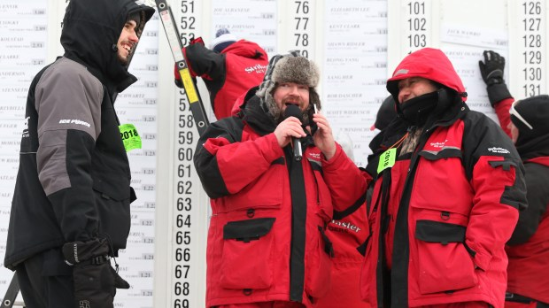 Stephen Lyogky (left) and his father Ivan Lyogky (right) from Hartville, Ohio, talking with radio host Brian Moon of B93.3. The Lyogkys took first and third place respectively with a 3.10 pound northern pike and 2.51 pound northern pike Saturday, Jan. 27, 2018, at the Jaycees Ice-fishing Extravaganza on Gull Lake. (Kelly Humphrey / Forum News Service)