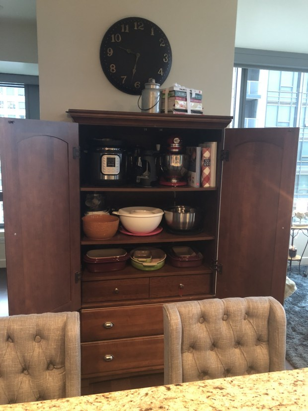 Downsizing required Melissa Schmalenberger to get creative with storage. Some kitchen items now sit in an armoire that once held clothes. (Special to Forum News Service)