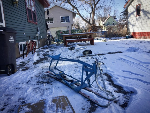 """Remnants of a Willmar man's """"rocket bike"""" was visible near the home, located in the 800 block of Third Street Southeast. According to a police report, a man tried to jump the bike off a roof Friday and was injured after landing on a fence. Attempts to contact the individual were not successful. (Forum News Service)"""