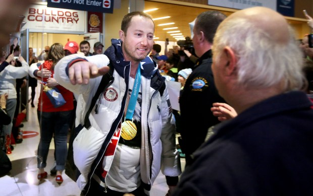 Tyler George and three other members of the gold-medal-winning U.S. Olympic men's curling team arrived at Duluth International Airport on Monday, Feb. 26, 2018, (Bob King / Forum News Service)