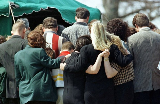 Friends and family console each other during the funeral service March 27, 1998, of Westside Middle School student Paige Ann Herring, 12, who was gunned down along with three other school mates and one teacher. (AP Photo/Rogelio Solis)