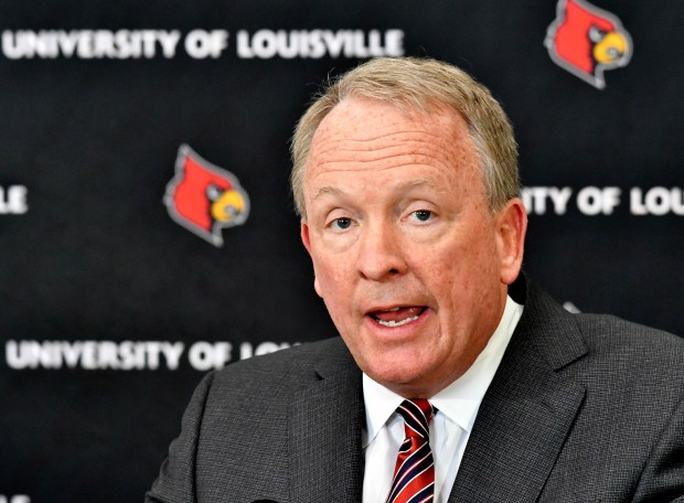 University of Louisville interim President Dr. Greg Postel speaks to the media during a news conference, Tuesday, Feb. 20, 2018, in Louisville, Ky. Louisville must vacate its 2013 men's basketball title following an NCAA appeals panel's decision to uphold sanctions against the men's program in the sex scandal case. The Cardinals will have to vacate 123 victories including the championship, and return some $600,000 in conference revenue from the 2012-15 NCAA Tournaments. (AP Photo/Timothy D. Easley)
