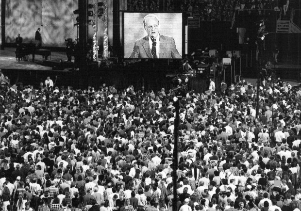 People crowd the floor of the Metrodome as they answer the call to the altar from Billy Graham on the fifth and final night of the Billy Graham Crusade in Minneapolis on June, 23, 1996. There were 70,000 people in attendance. (Buzz Magnuson / Pioneer Press)