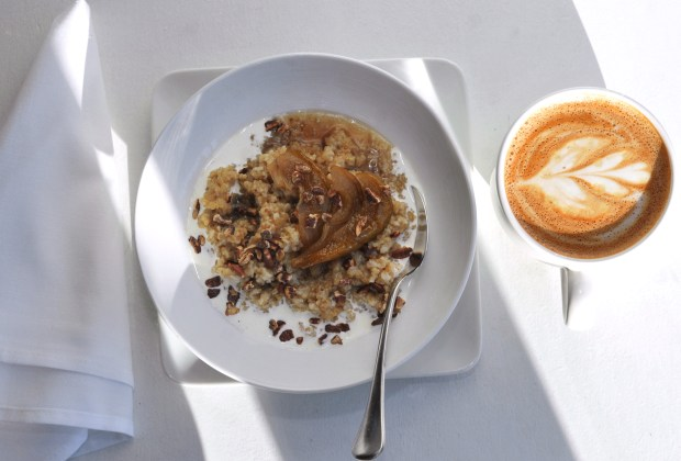 Hot cereal with steel-cut oats and quinoa, spicy pecans, maple roasted pears and cream for $7 at Salty Tart in the old Heartland building at 589 E. 5th Street in St. Paul is open for breakfast and lunch every day is run by Michelle Gayer, owner and chef. (Ginger Pinson / Pioneer Press)