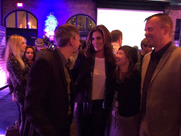 Cindy Crawford hangs with our crew David Jarosz (left), Nancy Ngo and Randy Wyland at the Pepsi Generations Live Pop-Up at Nicollet Island Pavilion on Friday, Feb. 2, 2018. (Jess Fleming / Pioneer Press)