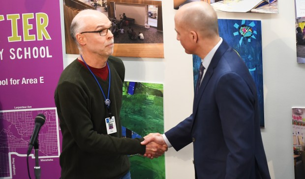 Nick Faber, president of the St. Paul Federation of Teachers, left, and Dr. Joe Gothard, St. Paul Public Schools Superintendent, shake hands following a press conference to talk about the negotiated St. Paul Teachers contract at Galtier Elementary School in St. Paul on Sunday, Feb, 12, 2018. (John Autey / Pioneer Press)