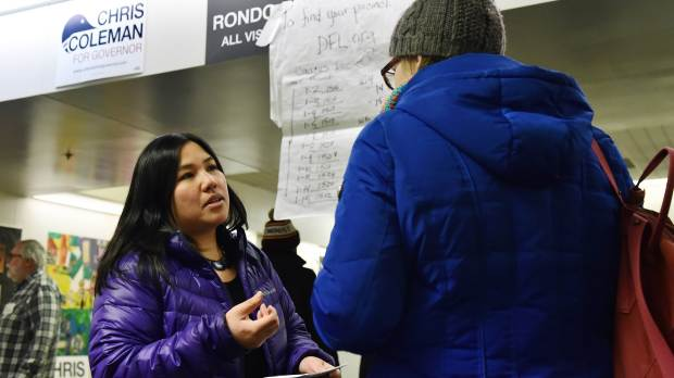 Jennifer Nguyen Moore, a candidate for Ramsey County commissioner, facing, speaks with Maggie Knorr at the St. Paul DFL Caucus at Capitol Hill Magnet School in St. Paul on Tuesday, Feb, 6, 2018. (John Autey / Pioneer Press)
