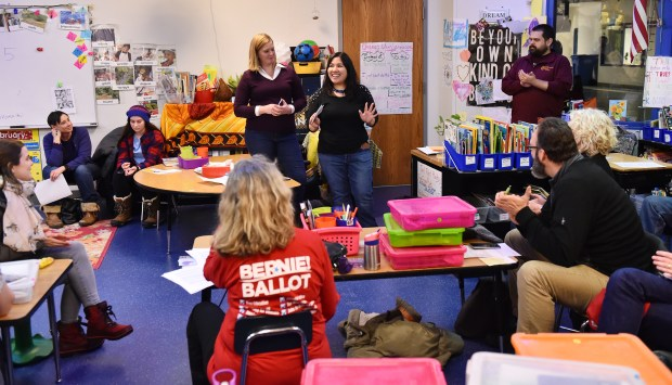 Jennifer Nguyen Moore, a candidate for Ramsey County commissioner, speaks to caucus goers at the St. Paul DFL Caucus at Capitol Hill Magnet School in St. Paul on Tuesday, Feb, 6, 2018. (John Autey / Pioneer Press)