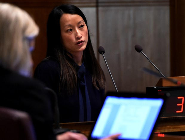 Pahoua Yang Hoffman, with The Citizen's League, a nonpartisan nonprofit, delivers a preliminary report to the St. Paul City Council in St. Paul City Hall Wednesday, Feb. 21, 2018, regarding the question of raising the minimum wage. (Jean Pieri / Pioneer Press)