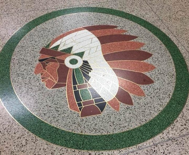 An American Indian emblem on the floor of Park High School in Cottage Grove will be removed, the district superintendent announced in March 2018. The artwork was installed in 1965 near the school gym. (Forum News Service)