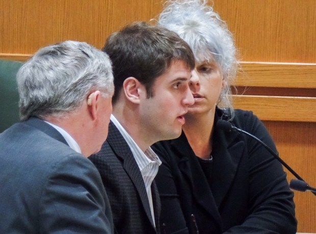 Alec Cook, center, enters guilty pleas to five felonies on Wednesday, Feb. 21, 2018. He is flanked by his lawyers Chris Van Wagner, left, and Jessa Nicholson Goetz. (Ed Treleven/Wisconsin State Journal via AP)