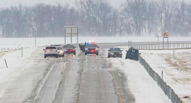 Law enforcement vehicles block westbound traffic along Interstate 94 just east of Moorhead after a Minnesota State Patrol trooper shot a woman in an encounter Monday, March 5, 2018.(David Samson / Forum News Service)