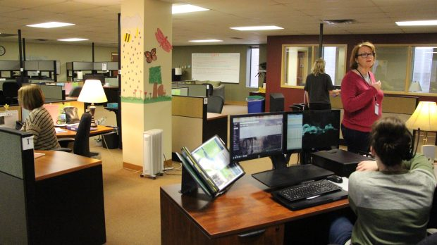 Crisis line counselors gather in the Call Center in Richfield, Minn. on Monday, March 26. (Callie Schmidt / Pioneer Press)