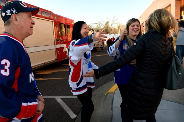 Marissa and Hannah Brandt greet a well wisher after arriving on fire trucks to a welcome home celebration at Vadnais Heights Commons in Vadnais Heights on Thursday, March 8, 2018. The girls' father, Greg, is on the left. The Olympian sisters represented two different countries, with Marissa competing with the Korean Women's Hockey Team and Hannah on the U.S. Women's Hockey Team at the PyeoneChang 2018 Olympic games. (Jean Pieri / Pioneer Press)