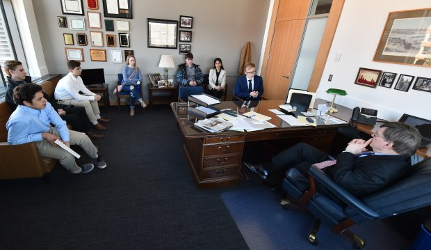 Minneapolis Roosevelt senior Ben Jaeger, second right, speaks with Sen. Richard Cohen, DFL-St. Paul, right, at the Minnesota Senate Office Building in St. Paul as he and a group of Minnesota high school students lobbying for stricter gun control laws met with legislators on Wednesday, March 14, 2018. (John Autey / Pioneer Press)