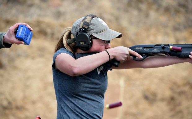 Dakota Overland, 14, a competitive shooter who travels to meets across the nation, works with her dad, Todd, at a gun range in Forest Lake on Friday, March 23, 2018. She speaks at the NRA and Second Amendment rallies. (Jean Pieri / Pioneer Press)