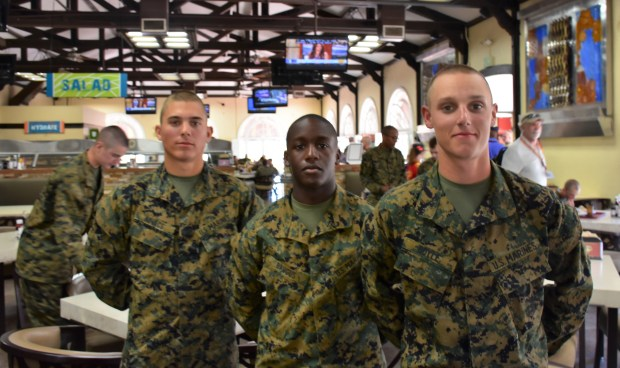 U.S. Marine Corps private Thomas Doyle, right, of St. Paul, stands with fellow privates Xavier Baugus, of St. Paul, center, and Adam Kovaks of Sioux Falls, S.D., during boot camp in San Diego on Feb. 20, 2018. All three are scheduled to graduate Marine boot camp on March 2. They have 10 days off after graduation, and then return for additional training. (S. M. Chavey / Pioneer Press)
