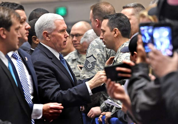 "Vice President Mike Pence shakes hands and talks with the military after delivering keynote remarks at an American First Policies ""Tax Cuts to Put America First"" event in Minneapolis Wednesday, March 28, 2018. (Jean Pieri / Pioneer Press)"