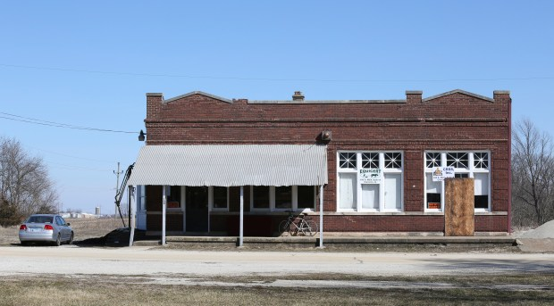 A building that housed Michael Hari's business is seen Wednesday, March 14, 2018, in Clarence, Ill. Hari, a former sheriff's deputy accused of being the ringleader in the bombing of a Minnesota mosque emerges in court documents as a sometimes-threatening figure with anti-government views who also wrote books and attracted others into his shadowy group. Hari, allegedly intended for the attack to scare Muslims into leaving the U.S. He and two associates were charged Tuesday, March 13, 2018m with traveling some 500 miles from rural Clarence, Illinois, about 120 south of Chicago, to carry out the Aug. 5, 2017 pipe-bomb assault on the Dar Al-Farooq Islamic Center in Bloomington, Minnesota. (AP Photo/Teresa Crawford)
