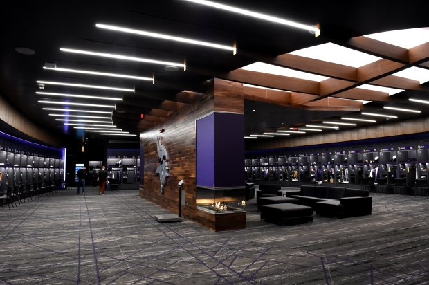 The Vikings locker room features lockers, fireplaces and a players' lounge area at the new Twin Cities Orthopedics Performance Center in Eagan on Friday, March 9, 2018. (Jean Pieri / Pioneer Press)