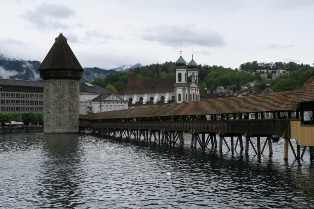 One of Lucerne's most iconic site is the Kapellbrucke, a covered wooden footbridge over the Reuss. (Liza Weisstuch/TNS)