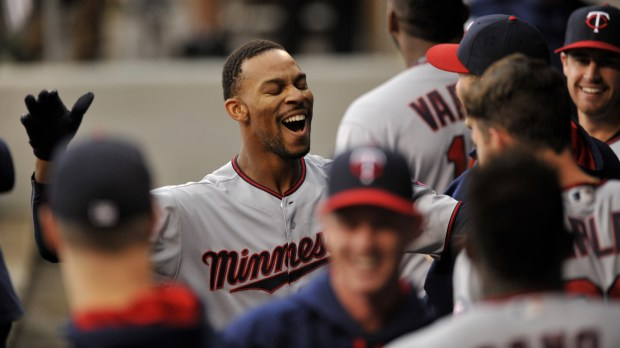 Minnesota Twins' Byron Buxton celebrates with teammates in the dugout after hitting an inside-the-park solo home run during the first inning of a baseball game against the Chicago White Sox, Sunday, Oct. 2, 2016, in Chicago. (AP Photo/Paul Beaty)
