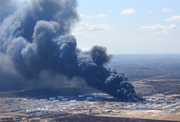 An enormous plume of smoke from a second fire at the Husky Energy refinery in Superior billows to the south. Residents within 10 miles in the direction of the smoke were evacuated. Thursday, April 26, 2018. (Bob King / Duluth News Tribune)