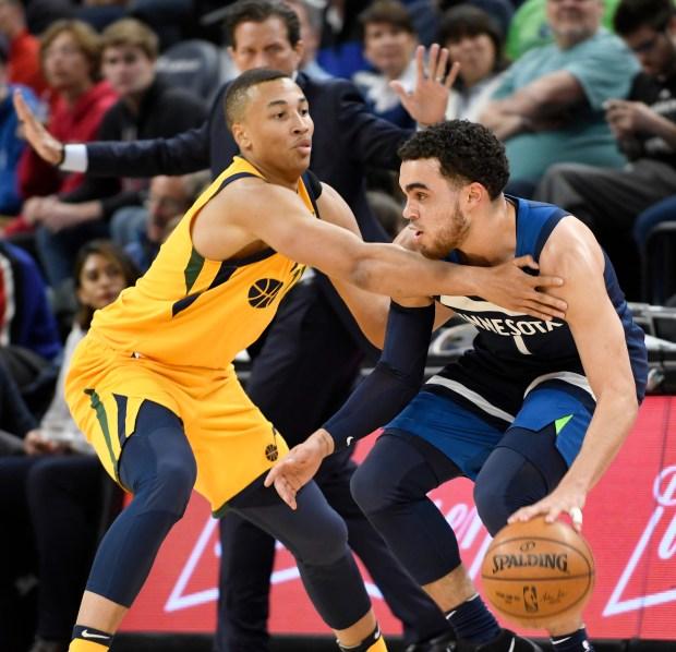Utah Jazz's Dante Exum, left, defends against Minnesota Timberwolves' Tyus Jones during the first quarter of an NBA basketball game Sunday, April 1, 2018, in Minneapolis. (AP Photo/Tom Olmscheid)