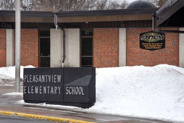 A sign marks one of the entrances to Pleasantview Elementary School on Monday, April 16, 2018, in Sauk Rapids, Minn. Authorities say an 8-year-old student took a kitchen knife to the central Minnesota elementary school and attacked three other children on Monday. (Dave Schwarz/St. Cloud Times via AP)