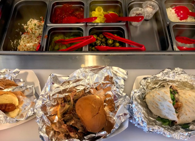 Hot dogs, pulled pork sandwiches and burritos are among the offerings at Boom Shack in St. Paul on April 3, 2018. (Nancy Ngo / Pioneer Press)