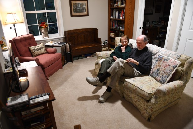 Grace and Jim Gibbs relax in their space, which includes the living area, a bedroom and a large bathroom. (Katherine Frey/The Washington Post)