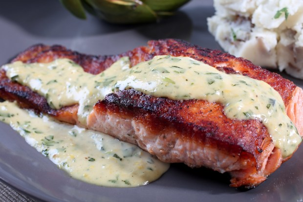 Salmon Fillet with a Lemon, Tarragon and Garlic Sauce photographed in the St. Louis Post-Dispatch photo studio on Wednesday, March 21, 2018, in St. Louis, Mo. (Nikos Frazier/St. Louis Post-Dispatch/TNS)