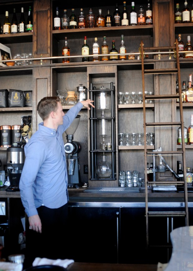 Lead barista Colin Jarvis explains the cold press coffee maker at Hodges Bend, a coffee shop that is also a restaurant and a cocktail bar on University Avenue in St. Paul, on Tuesday, April 17, 2018. (Lisa Legge / Pioneer Press)
