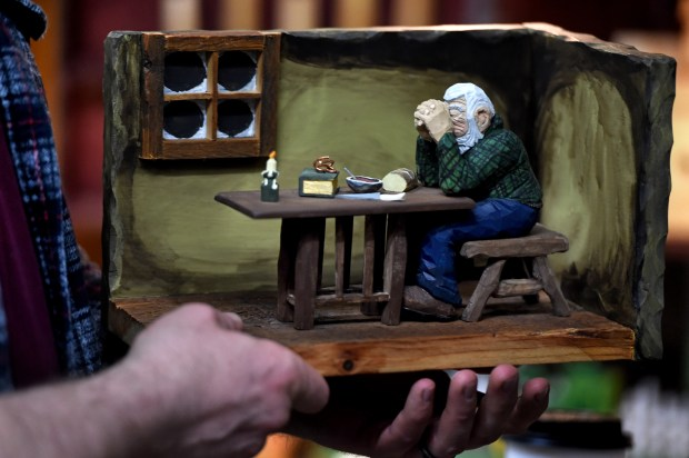 """Tanner Spicer shows the wood sculpture diorama from the painting """"Grace"""" that he gave to his mother for Christmas in 2017. (Jean Pieri / Pioneer Press)"""