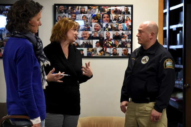 "After a meeting, Listening House executive director, Cheryl Peterson, center, standing by Julie Borgerding talks with St. Paul Police Mental Health Unit officer Titus Marshall, who will be covering the area the Listening House is located in, on Wednesday, March 14, 2018 in St. Paul. Last year the mayor agreed to add four new officers to the St. Paul police budget for 2018 to form a mental health unit. ""This is going to be a great partnership,"" said Peterson. (Jean Pieri / Pioneer Press)"