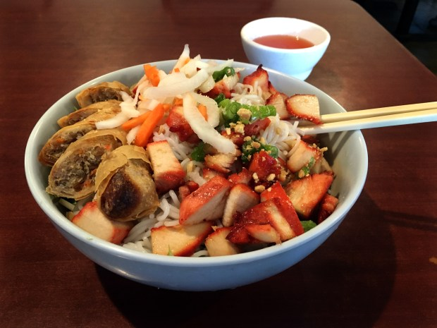 Bun salad with chicken and egg roll from iPho by Saigon, April 19, 2018. (Jess Fleming / Pioneer Press)